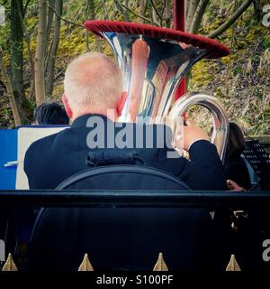 Tuba player in brass band - Stock Photo