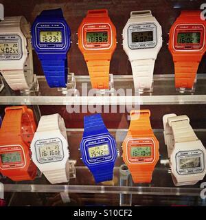 Brightly coloured retro digital watches - Stock Photo