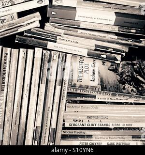 Box of books in a secondhand bookshop - Stock Photo