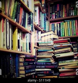 Piles of books in secondhand bookshop - Stock Photo