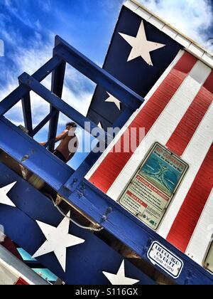Stars and Stripes lifeguard station - Stock Photo
