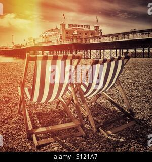 Deckchairs on brighton beach - Stock Photo