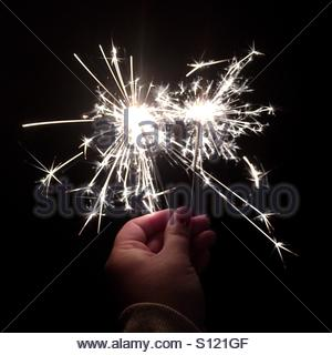 Hand holding sparklers - Stock Photo