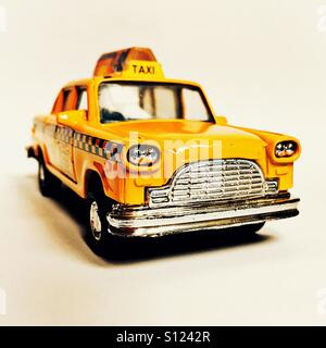 Toy model of yellow new york taxi - Stock Photo