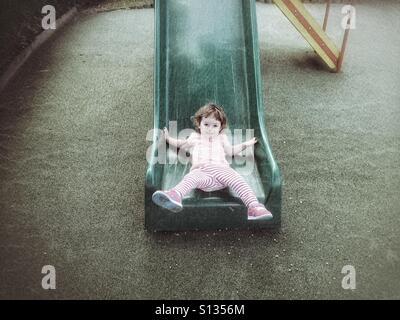 Toddler on slide - Stock Photo