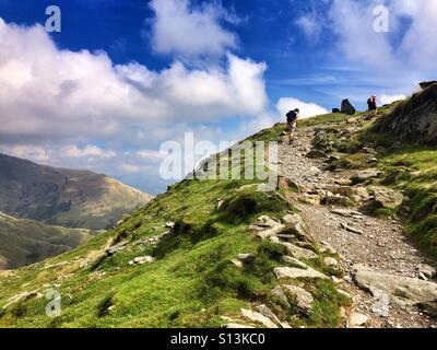 Hiking up the Old Man of Coniston, Lake District, Cumbria - Stock Photo