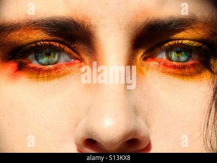 Closeup of young woman's eyes, green eyes with makeup - Stock Photo