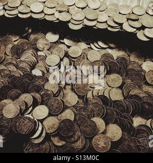 Penny pusher falls in an amusement arcade - Stock Photo