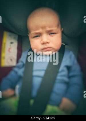 Baby boy in baby buggy - Stock Photo