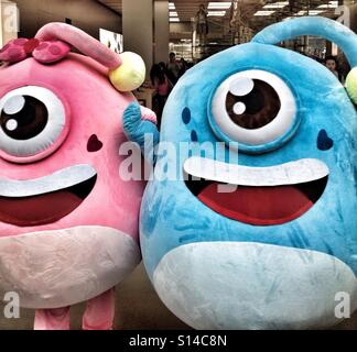 Two Blue & Pink Costumed Alien Beings Invade The Earth With Hearts & Love, Men Are From Mars, Women Are From Venus - Stock Photo