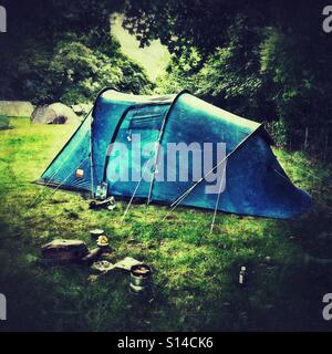 A tent in a field - Stock Photo
