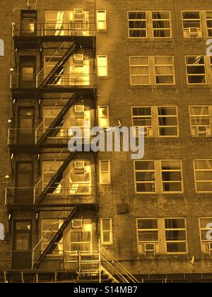 Sepia - exterior fire escape stairway on an old office building - Stock Photo