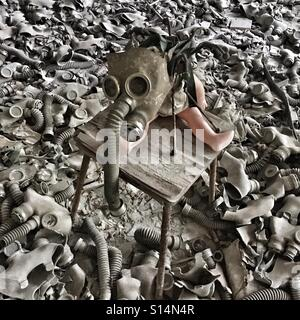 Doll in abandoned school in Prypiat ghost town, Chernobyl Nuclear Power Plant Zone of Alienation, Ukraine - Stock Photo