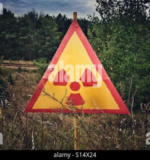 Radiation Sign in Chernobyl Nuclear Power Plant Zone of Alienation, Ukraine - Stock Photo