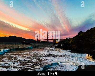 San Francisco view of the Golden Gate Bridge at sunset from Baker Beach - Stock Photo
