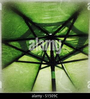 Under a green umbrella taken with grunge film