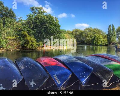 Upturned boats in a row by the lake in Finsbury Park, North London, UK - Stock Photo