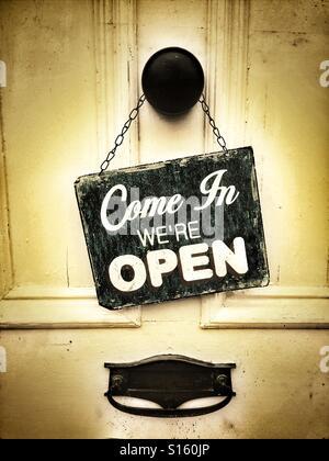 Shop open sign on door - Stock Photo