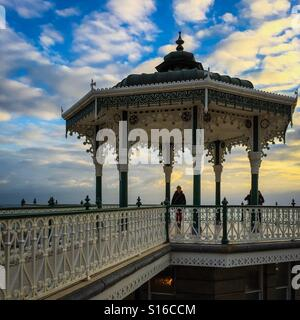 Old bandstand overlooking Brighton beach during sunset - Stock Photo