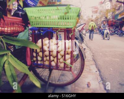 Street vendor with eggs on back of bicycle in Southeast Asia - Stock Photo