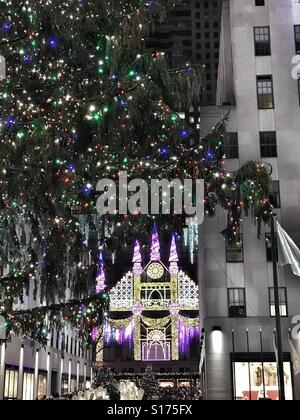 Christmas Tree and Saks Fifth Avenue Light Show at Rockefeller Center in New York City - Stock Photo