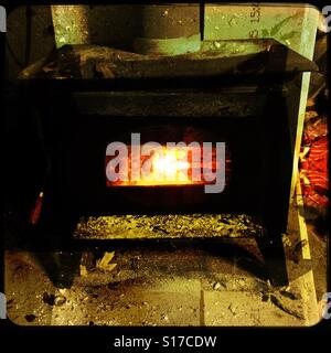 Old wood stove in my garage - Stock Photo