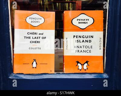 Secondhand Penguin fiction paperbacks for sale in a bookshop in Hay on Wye Wales UK - Stock Photo