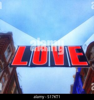 A love sign Christmas sign on Carnaby Street, London - Stock Photo