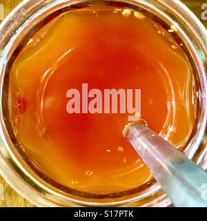 Thai condiments- chilli vinegar - Stock Photo