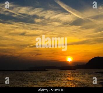 Winter Sunset over the sea - Stock Photo