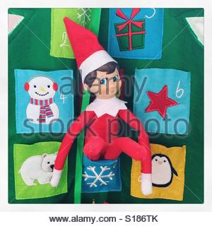 Christmas elf on the shelf - Stock Photo