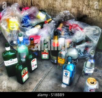 Loads of empty alcohol bottles after a party - Stock Photo