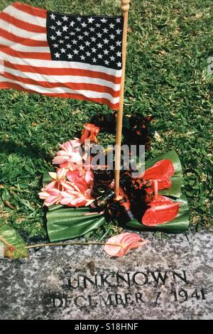 A grave of an unknown soldier taken at the National Memorial Cemetery of the Pacific in the Punchbowl crater in - Stock Photo