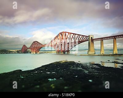 The Beautiful Forth Railway Bridge over the Firth of Forth at South Queensferry near Edinburgh Scotland United Kingdom - Stock Photo