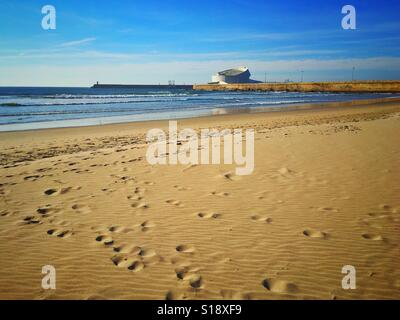 Atlantic Ocean beach in Porto, Portugal. View with building of cruise terminal - Stock Photo