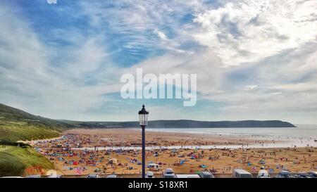 Woolacombe beach and bay in high summer, Devon, UK, busy with holidaymakers - Stock Photo