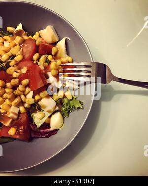 Salad in a grey plate. Corn, Tomatoes and mozzarella Salad with honey mustard dressing. Healthy Salad. Healthy Homemade - Stock Photo