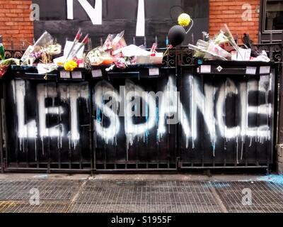 Graffiti and tributes left at David Bowie's New York apartment in days after he died there. - Stock Photo