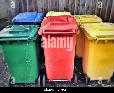 Coloured recycling wheely bins - Stock Photo