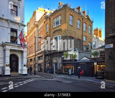 At the south end of Savile Row, two small lodges flank the rear entrance to Albany, London, UK. - Stock Photo