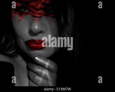 Closeup woman wearing red makeup - Stock Photo