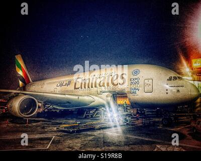Emirates Airline aircraft parked at the gate - Stock Photo