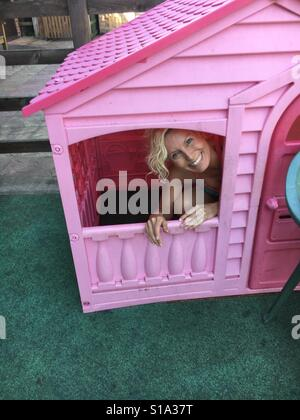 Fun in the Wendy house - Stock Photo
