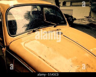 Yellow Volkswagen Beetle 1303 hood view - Stock Photo