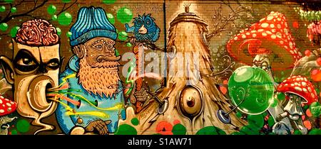 Old Man in a Mystical Forest with Creatures & Toadstools Street Art. Munich - Stock Photo