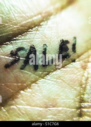 Sale word written on palm - close-up shot - Stock Photo