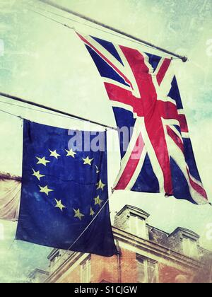 The Union Jack & the European Union flags flying side by side. - Stock Photo