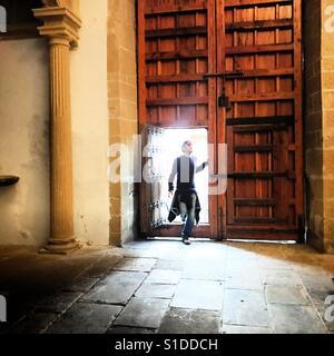 A man enters a church in Baeza, Jaen province, Andalusia, Spain - Stock Photo