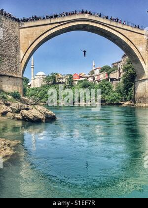 Daredevil jumping from Old Bridge in Mostar, Bosnia - Stock Photo