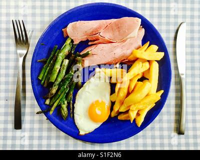 Ham egg chips and asparagus - Stock Photo